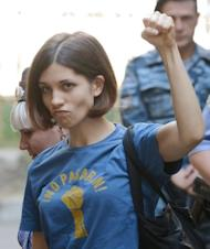 Russian punk singer Nadezhda Tolokonnikova gestures before a court hearing in Moscow. Tolokonnikova -- the lead singer of the Russian punk band Pussy Riot -- has compared the group's trial to Stalin-era repressio in a dramatic final statement before the verdict is delivered later this month