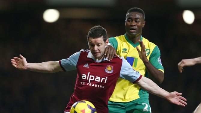 West Ham United's Jarvis challenges Norwich City's Tetley during their English Premier League soccer match at the Boleyn Ground in London