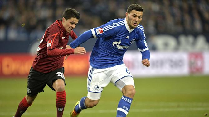 Schalke's Sead Kolasinac, right, and Hannover's Leonardo Bittencourt challenge for the ball during the German Bundesliga soccer match between FC Schalke 04 and SV Hannover 96 in Gelsenkirchen,  Germany, Sunday, Feb. 9, 2014