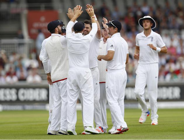 England's James Anderson and Joe Root celebrate taking the wicket of Pakistan's Shan Masood with Alastair Cook and teammates
