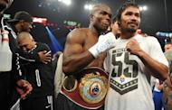 Timothy Bradley (L) celebrates his victory over Manny Pacquiao on June 9. Judge Jerry Roth scored the bout 115-113 for Pacquiao, while C.J. Ross and Duane Ford both saw it 115-113 for Bradley, even though it appeared Pacquiao hurt Bradley throughout the fight