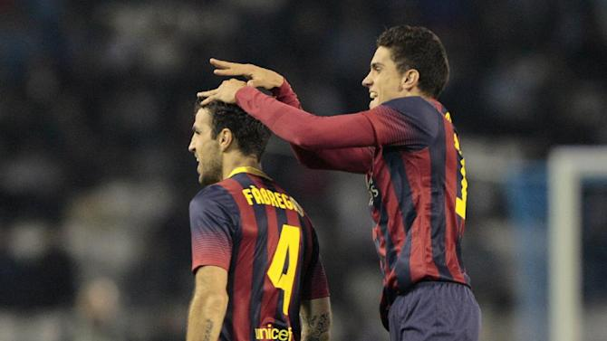 FC Barcelona's Cesc Fbregas, left, reacts with Marc Bartra Aregall, right, after scoring the second goal against RC Celta during a Spanish La Liga soccer match at the Balaidos stadium in Vigo, Spain, Tuesday, Oct. 29, 2013
