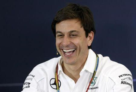 Mercedes Formula One Executive Director Wolff smiles during a news conference after the second practice session of the Australian F1 Grand Prix in Melbourne