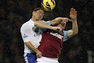 Everton midfielder Steven Pienaar (L) and West Ham United's James Collins jump for the ball during their Premier League match on December 22, 2012. Everton surged into fourth place with a 2-1 win over West Ham at Upton Park