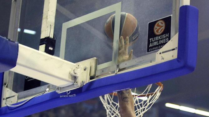 Nikos Pappas of Panathinaikos Athens, right, blocks a shot by Red Star's Jaka Blazic during their Round 3 Euroleague basketball match in Belgrade, Serbia, Friday, Nov. 1, 2013