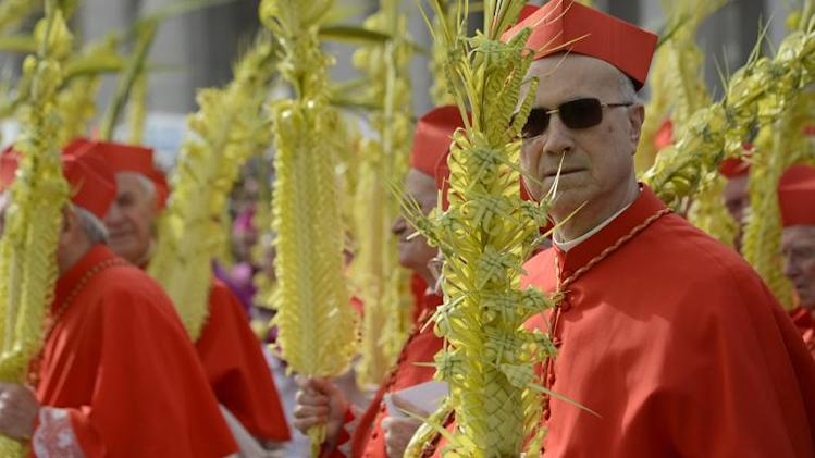 Cardinal Tarcisio Bertone walks in procession on St Peter's square before a papal mass as part of the Palm Sunday celebration on March 24, 2013 at the Vatican