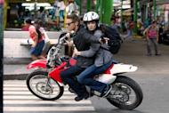 """This film image released by Universal Pictures shows Rachel Weisz as Dr. Marta Shearing, right, and Jeremy Renner as Aaron Cross in a scene from """"The Bourne Legacy."""" (AP Photo/Universal Pictures, Mary Cybulski)"""