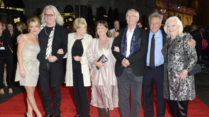 "FILE - In this Oct. 15, 2012 file photo, from left, Sheridan Smith, Billy Connolly, Dame Maggie Smith, Pauline Collins, Tom Courtenay, Dustin Hoffman and Dame Gwyneth Jones pose at the London Film Festival American Airlines Gala -Quartet at Odeon West End, in London. The 75-year-old Hoffman went behind the camera for ""Quartet,"" starring Smith, Courtenay, Connolly and Collins as aging British opera divas at a retirement home for musicians who put aside past differences for a reunion concert. (Photo by Jon Furniss/Invision, File)"
