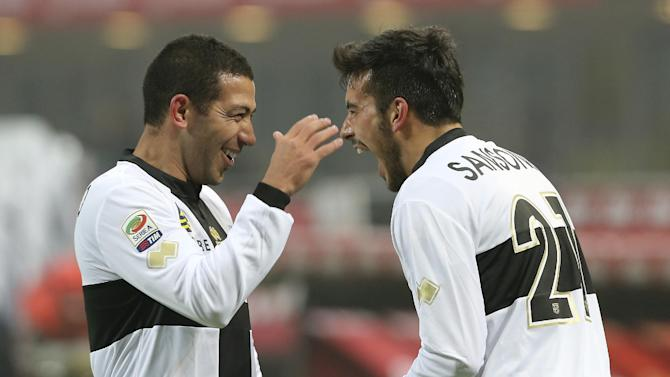 Parma forward Nicola Sansone, right, celebrates with his teammate Walter Gargano, of Uruguay, after scoring during the Serie A soccer match between Inter Milan and Parma at the San Siro stadium in Milan, Italy, Sunday, Dec. 8, 2013