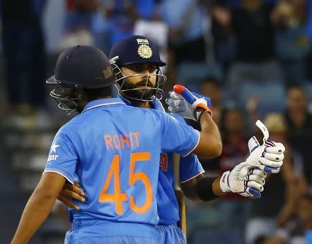 India's batsmen Rohit Sharma and Virat Kohli embrace after defeating the UAE at their Cricket World Cup match in Perth