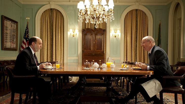 "Paul Giamatti as Ben Bernanke and William Hurt as Henry Paulson in ""Too Big to Fail."""