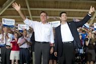 """US Republican presidential candidate Mitt Romney (L) and his running mate Paul Ryan wave at a rally in Manassas, Virginia, on August 11. Romney and Ryan will try to energize supporters in North Carolina Sunday after they hit the road on a bus tour across must-win US states, selling themselves as the duo who can """"save the American dream."""""""