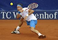 Argentina's Juan Monaco returns the ball to Serbia's Janko Tipsarevic in the final of the ATP tennis tournament in Stuttgart, southwestern Germany, on July 15, 2012. AFP PHOTO THOMAS KIENZLE