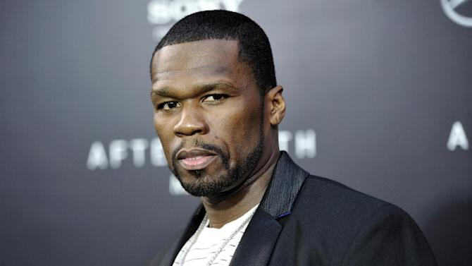 "FILE - This May 29, 2013, file photo, shows rapper Curtis ""50 Cent"" Jackson at the Ziegfeld Theatre in New York. Rapper and actor 50-Cent is scheduled to face arraignment Monday, Aug. 5, 2013, on charges that he attacked his ex-girlfriend and trashed her condo. (Photo by Evan Agostini/Invision/AP, File)"