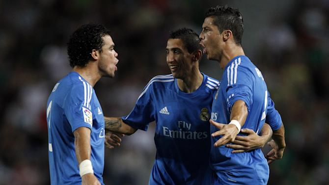 Real Madrid's Cristiano Ronaldo from Portugal reacts with fellow team members, Pepe from Portugal, right, and Angel Di Maria from Argentina, center, after Ronaldo scored a goal against Elche during their La Liga soccer match at the Martinez Valero stadium in Elche, Spain, Wednesday, Sept. 25, 2013