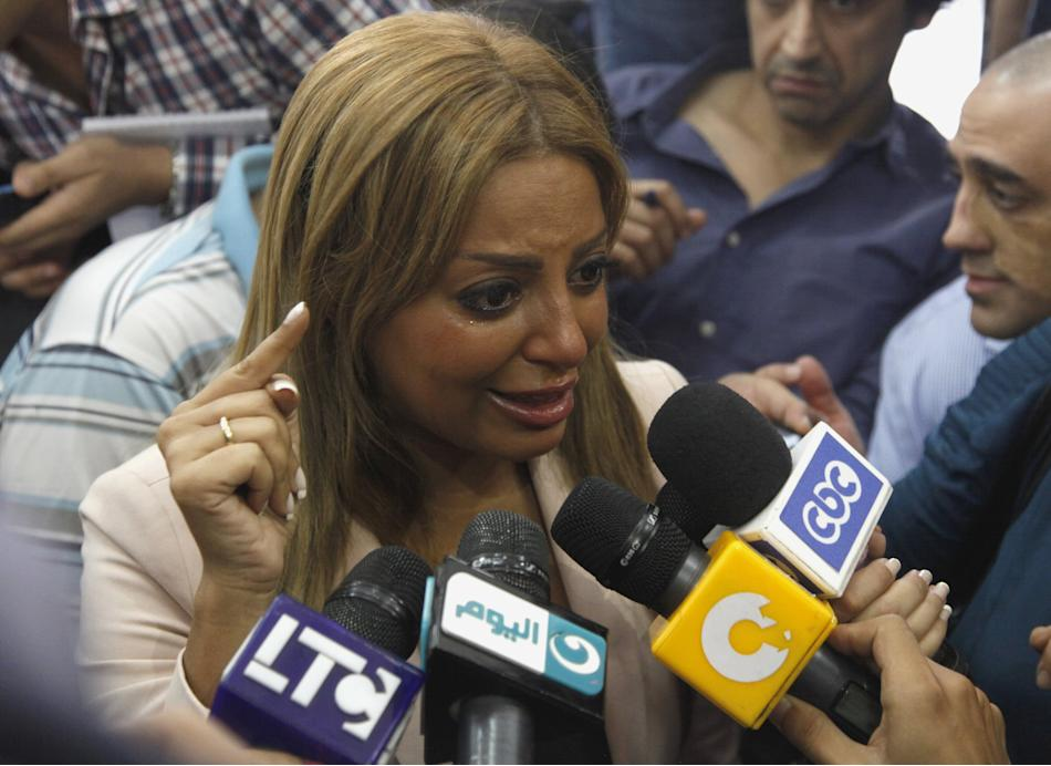 Omara talks to the media in Cairo