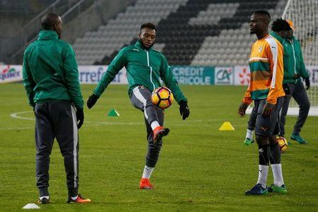 Ivory Coast's players attend a training session