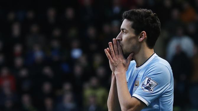 Manchester City's Navas reacts after missing a scoring opportunity against Norwich City during their English Premier League soccer match at Carrow Road in Norwich, eastern England