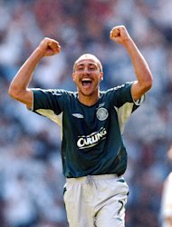 Henrik Larsson celebrates during his playing days at Celtic