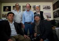 """Agence France-Presse (AFP) photographer Massoud Hossaini (R) poses with colleagues including Shah Marai (L) and Lawrence Bartlett (C) at the AFP office in Kabul. Hossaini won the Pulitzer award for breaking news photography """"for his heartbreaking image of a girl crying in fear after a suicide bomber's attack at a crowded shrine in Kabul,"""" the committee announced"""