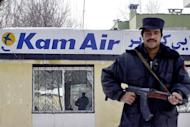 An Afghan soldier guards the Kam Air office in Kabul, on February 4, 2005. The United States has suspended its blacklisting of Kam Air after the Afghan government promised an investigation into claims of opium trafficking by the airline, NATO's coalition force in Afghanistan ISAF announced Monday