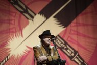 "Singer Neil Young speaks during a news conference before the last concert in his ""Honour the Treaties"" tour in Calgary, Alta., Sunday, Jan. 19, 2014. THE CANADIAN PRESS/Jeff McIntosh"