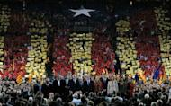 Artur Mas (C), leader of Spain's Catalonia region, stands amid supporters at the end of a final meeting for his re-election campaign. Mas vowed on Friday to fight for the 'future of our nation' before a roaring crowd of supporters, ahead of weekend elections that could lead to a popular demand for statehood.