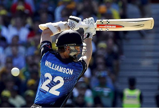 New Zealand's Kane Williamson misses hitting a delivery from Australia's Mitchell Starc during their Cricket World Cup final match at the MCG