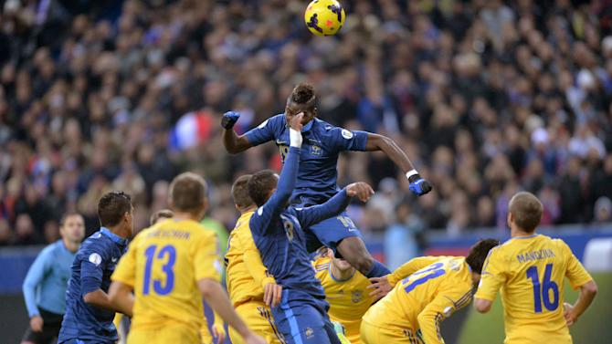 PARIS, Nov. 20, 2013 (Xinhua/IANS) -- Paul Pogba (above) of France heads the ball during the 2014 World Cup qualifying second leg playoff soccer match between France and Ukraine in Paris, France, on Nov. 19, 2013. France won 3-2 in total to be qualified for the final stage of the 2014 World Cup. (Xinhua/Chen Xiaowei)