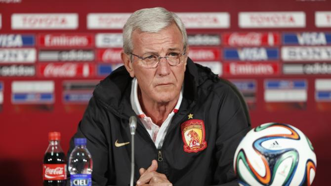 Marcello Lippi, coach of China's Guangzhou Evergrande, speaks during a news conference ahead of the Club World Cup, in Agadir
