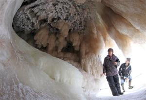Sightseers look at ice formations in sea caves of the Apostle Islands National Lakeshore of Lake Superior