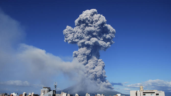 In this photo released by Kagoshima Local Meteorological Observatory, volcanic smoke billows from Mount Sakurajima in Kagoshima, on the southern Japanese main island of Kyushu Sunday, Aug. 18, 2013. Kyodo reported that it erupted Sunday evening, marking the 500th eruption this year at the 1,117 meters (3,686 foot) high mountain, which is one of Japan's most active volcanoes. There is no immediate reports of injuries. (AP Photo/Kagoshima Local Meteorological Observatory) CREDIT MANDATORY