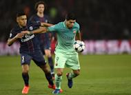 Barcelona forward Luis Suarez (right) in action during the Champions League match against Paris Saint-Germain on February 14, 2017