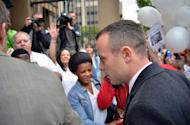 Oscar Pistorius arrives at court in Pretoria on April 14, 2014