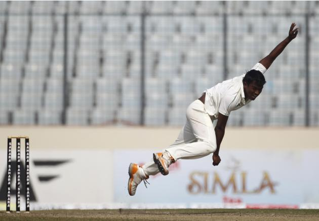 Bangladesh's Hossain bowls against Sri Lanka during third day of first test cricket match of series in Dhaka