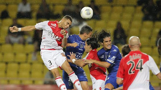 Monaco's Layvin Kurzawa of France, left challenges for the ball with Bastia's Claudiu Keseru of Romania, scond from left,  during their French League One soccer match, in Monaco stadium, Wednesday, Sept, 25, 2013