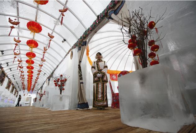 A waitress poses during a photo opportunity at the Ice Palace in Shangri-La Hotel in Harbin