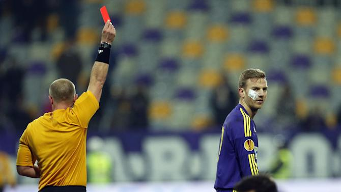 Maribor's Ales Mertelj, right rear, receives a red card after tackling Wigan's Jordi Gomez, right, during their group D Europa League soccer match, in Maribor, Slovenia, Thursday, Dec. 12, 2013