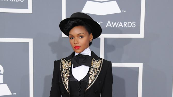 FILE - In this Feb. 10, 2013 file photo, Janelle Monae arrives at the 55th annual Grammy Awards in Los Angeles.  Monae says she's an avid thrift shopper, namedropping stores like Little Five Points, Ragarama and Poor Little Rich Girl as her favorites in her Atlanta hometown. (Photo by Jordan Strauss/Invision/AP, File)