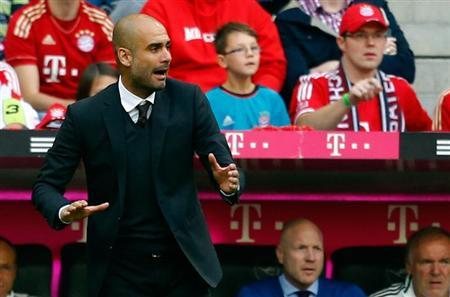 Pep Guardiola, coach of FC Bayern Munich gestures during their German first division Bundesliga soccer match against Hertha Berlin in Munich October 26, 2013. REUTERS/Michael Dalder
