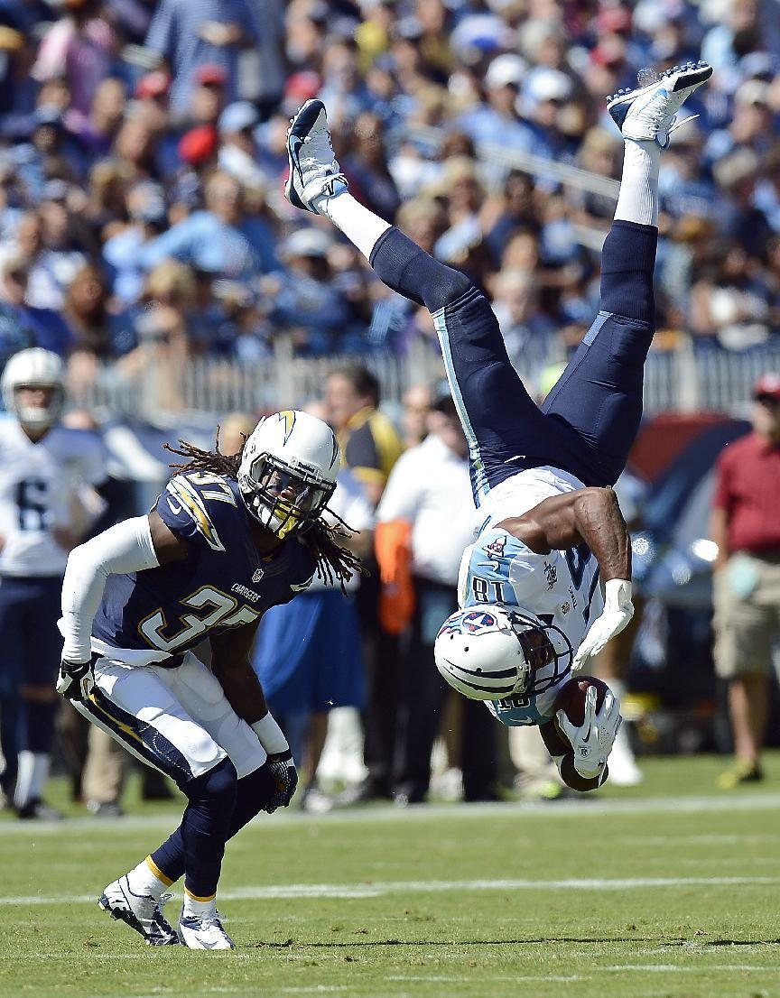 Tennessee Titans wide receiver Kenny Britt (18) flips upside down after making a catch as he is defended by San Diego Chargers defensive back Jahleel Addae (37) in the second quarter of an NFL footbal