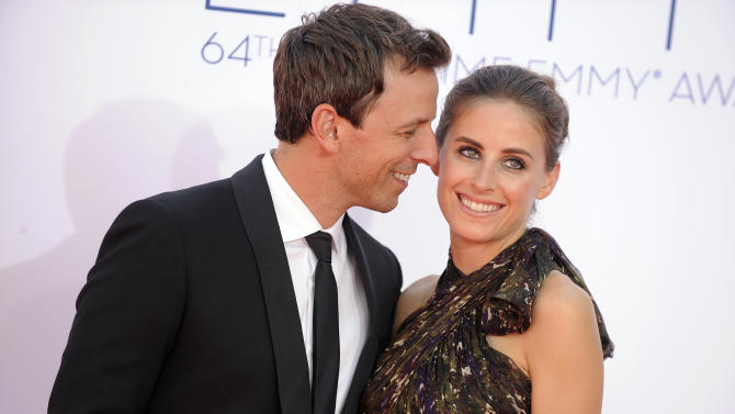 Actor Seth Meyers, left and wife Alexi Ashe arrive at the 64th Primetime Emmy Awards at the Nokia Theatre on Sunday, Sept. 23, 2012, in Los Angeles.  (Photo by Jordan Strauss/Invision/AP)