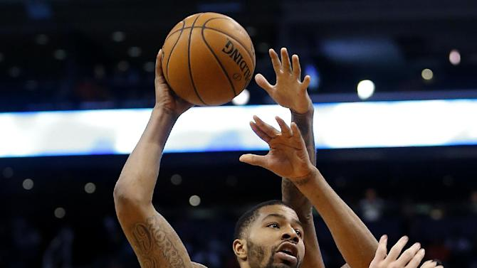 Phoenix Suns' Markieff Morris (11) shoots against the Portland Trail Blazers during the second half of an NBA basketball game, Wednesday, Nov. 27, 2013, in Phoenix. The Suns won 120-106