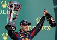 Red Bull Formula One driver Sebastian Vettel of Germany celebrates with his trophy on the podium after winning the Austin F1 Grand Prix at the Circuit of the Americas in Austin November 17, 2013. REUTERS/Adrees Latif