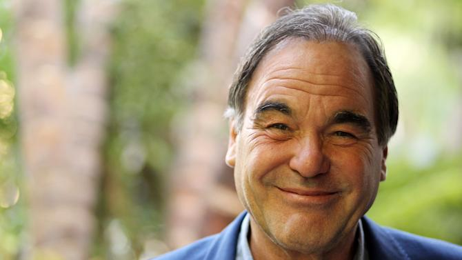"""In this Friday, June 15, 2012 photo, director, Oliver Stone, poses for a portrait in Beverly Hills, Calif. Stone is taking his passion for marijuana to the big-screen with his new drug-war thriller film """"Savages."""" (Photo by Matt Sayles/Invision/AP)"""