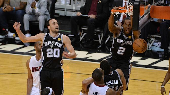 Basketball - Spurs dominate Heat to move to within one win of title