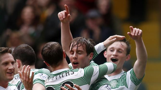 Celtic's Stefan Johansen is congratulated by Leigh Griffiths on his goal against St Mirren during their Scottish Premier League soccer match at Celtic Park Stadium in Glasgow