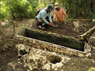 A photo released by Philippine National Museaum (PNM) shows archaeologists working on a limestone coffin in Mulanay town, Quezon province, southeast of Manila. Philippine archaeologists said they had discovered a thousand-year old cemetery of rock coffins in a rainforest, but that tomb-raiders had found it decades earlier and stolen precious artefacts