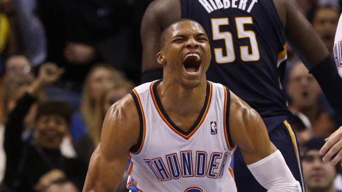 Oklahoma City Thunder guard Russell Westbrook (0) celebrates during the third quarter of an NBA basketball game against the Indiana Pacers in Oklahoma City, Sunday, Dec. 8, 2013. Oklahoma City won 118-94