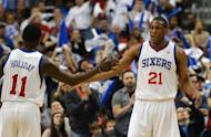 Jrue Holiday and Thaddeus Young of the Philadelphia 76ers celebrate after their team wins 89-82 against the Chicago Bulls in game four of the NBA Eastern Conference playoff game on May 6. Philadelphia have won three straight games